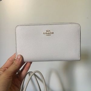 White and gold Coach wristlet / wallet phone case